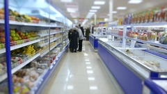Food store, customers make purchases in the supermarket Stock Footage