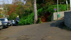 TOURISTS ON SLEIGH RIDE MONTE FUNCHAL MADEIRA Stock Footage