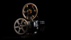 Retro projector showing film. Studio black background Stock Footage