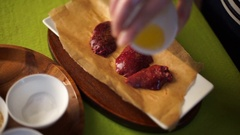 Chicken liver sprinkled with spices laid out on a beautiful plate, poured the Stock Footage