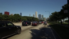 Driving along South Lake Shore Drive on a sunny summer day Stock Footage