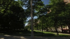 Drive by of a city park in Chicago Illinois Stock Footage
