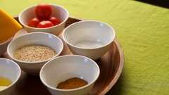 Ingredients for salad with pumpkin. Spices, pumpkin, tomatoes, sesame seeds Stock Footage