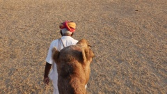 Point of View of a ride of camel in sand dunes in the desert Stock Footage