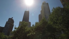 Drive shot of downtown Chicago as the Sears Tower is revealed. Stock Footage