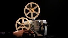 Projector. Rewinding the film from one the reel to another Stock Footage