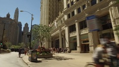 Drive shot of shoppers enjoying a beautiful summer day in midtown Chicago. Stock Footage