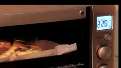 Fish pieces cooking in the modern electronic oven. Stock Footage