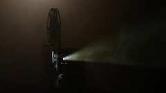 Shows movie in a projector in the smoke. Black background Stock Footage