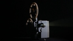 In the studio shows movie in a projector. Black background Stock Footage