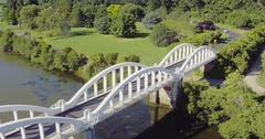 Aerial shot of car driving on a bridge over the waikato river, New Zealand Stock Footage