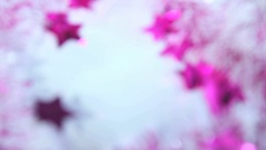 Beautiful blurry violet Christmas background with glittering stars Stock Footage