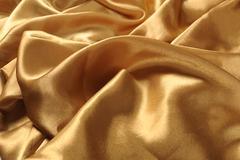 Wavy folds of satin velvet material or luxurious background Stock Photos