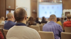 Businesssman with Bluetooth headset listening in conference hall Stock Footage