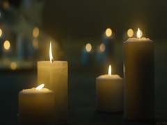 A lot of burning candles on the floor. Candles burning in the dark Stock Footage