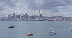 Aerial shot of boats in Auckland harbour & city skyline, New Zealand Stock Footage