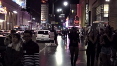 Police officer and people in costumes on Halloween walking on Hollywood LA Stock Footage