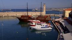 PLEASURE BOATS PIRATE SHIP HARBOUR RETHYMNON CRETE Stock Footage