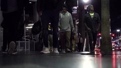 People walking on Hollywood Boulevard low angle Walk of Fame night Halloween LA Stock Footage