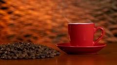 Cup on a red saucer of hot coffee on the aroma spreads room Stock Footage