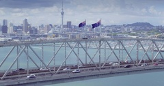 Aerial shot of Auckland harbour bridge & city skyline, New Zealand Stock Footage