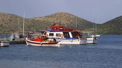 FISHING BOAT MOORS IN HARBOUR ELOUNDA CRETE GREECE Stock Footage