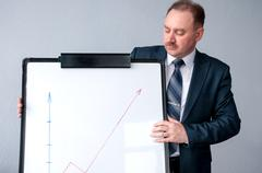 Man considers the schedule arrived at the whiteboard Stock Photos