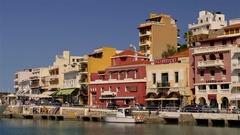 HOTELS SHOPS AT HARBOUR AGIO NIKOLAOS CRETE GREECE Stock Footage
