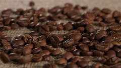 Selected grain fragrant coffee brown burlap fall on lying. Close-up Stock Footage