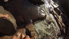 Pov walking up a set of rapids Stock Footage