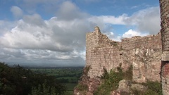 Time lapse of clouds over castle Stock Footage