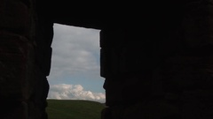 Castle window as clouds move through Stock Footage