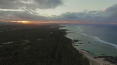 Flying along the coastline of Mauritius at sunset Stock Footage