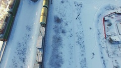 Top view of two freight trains with carriages on railways at winter Stock Footage
