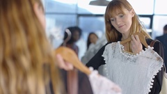 4K Customers shopping & sales assistant at the counter in fashion clothing store Stock Footage