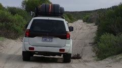 4x4 Vehicle driving over bumpy sand road Stock Footage