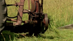 Tractor mowing hay large frame Stock Footage