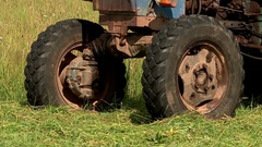 The tractor in the village begins work on the hay Stock Footage
