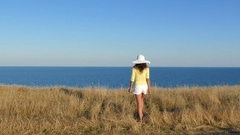 4K. Woman expresses emotions in  summer, lifting hands up against sea Stock Footage