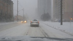 Driving on Pape Avenue in snowstorm. Toronto, Canada. Stock Footage