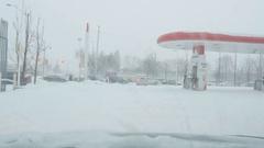 Entering PetroCanada station in snowstorm. Toronto, Canada. Stock Footage