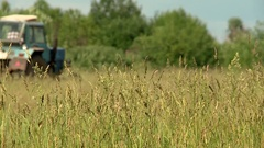 Tractor summer mowing grass for cows Stock Footage