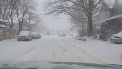 Driving in a snowstorm. Intersection with stop sign. Toronto, Canada. Stock Footage