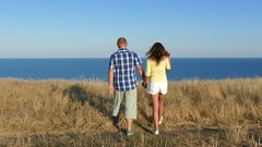 4K. Feelings of love. Adult couple embrace  against sea.  Stock Footage