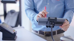 4K Close up on hands customer making payment with smartphone in clothing store.  Stock Footage