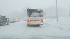 Behind TTC bus during snowstorm. East York, Toronto, Canada. Stock Footage