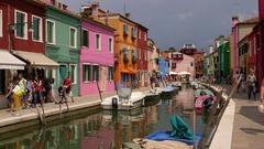 COLOURED HOUSES BOATS BURANO VENICE ITALY Stock Footage