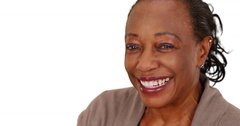 Close-up of a laughing elderly African American woman on a white background Stock Footage