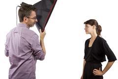 Photographer in Studio and Model Stock Photos