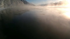 Floating over Misty Icy Chilkat River Aerial in Winter HD Stock Footage